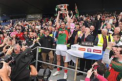 5 in a Row, Mayo captain Keith Higgins lifts the Nestor Cup in Hyde Park after Mayo Connacht Final win over Sligo on sunday.<br /> Pic Conor McKeown
