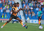Brighton striker Tomer Hemed and Hull City midfielder Moses Odubajo go shoulder to shoulder during the Sky Bet Championship match between Brighton and Hove Albion and Hull City at the American Express Community Stadium, Brighton and Hove, England on 12 September 2015. Photo by Bennett Dean.