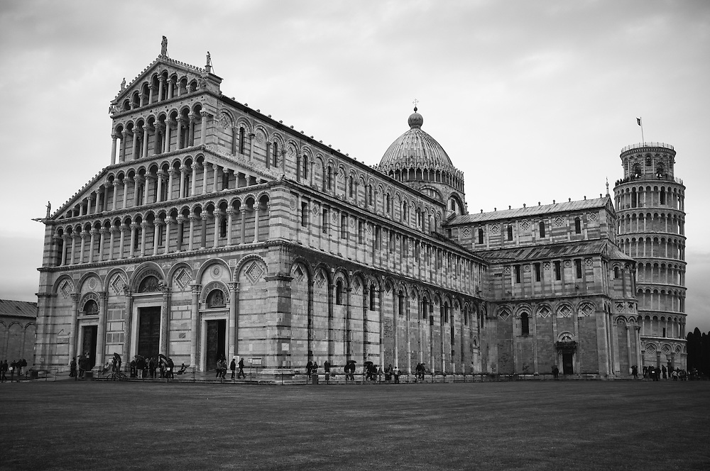 The Duomo (cathedral) in the PIazza dei Miracoli with the Leaning Tower of Pisa in the background in Pisa, Italy