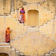 Indian women in the step well near Kheri Gate, Amer, Jaipur, Rajasthan, India