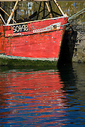 Trawler reflection in water, Howth harbour Dublin, Carraig Bui (yellow rock)
