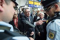 """23 JUN 2016, BERLIN/GERMANY:<br /> Thomas de Maiziere (L), CDU, Bundesinnenminister, und Klaus Dauderstaedt (R), Vorsitzender Deutscher Beamtenbund, dbb, im Gespraech mit Beamten der Bundespolizei - de Maiziere zeigt auf eine Bodycam, waehrend der Vorstellung einer Aktion gegen Gewalt gegen Beschäftigte im öffentlichen Dienst """"Für Sie - für mich - Respekt"""", Hauptbahnhof<br /> IMAGE: 20170623-01-006<br /> KEYWORDS: Thomas de Maizière, Klaus Dauderstädt"""