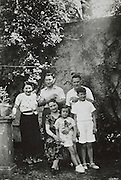family together in their garden for a group photo 1936 France