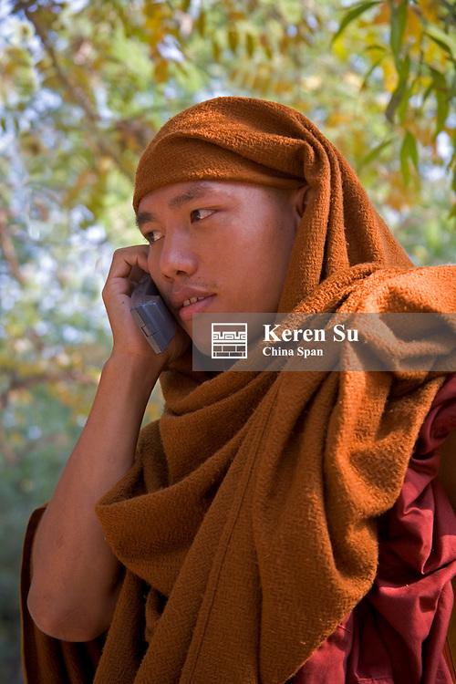 Monk using cellular phone, Mandalay, Myanmar