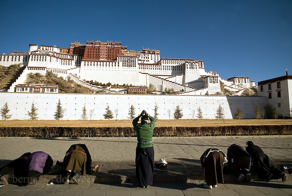 Tibetan Pilgrims pray in the Tibetan Capital, Lasa, during the celebrations of Tibetan New Year, in Lasa. Tibet, China/Feb. 22, 2007.