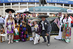 fans of Mexico with in traditional clothing together with fans of Saudi Arabia in the front of Luzhniki Stadium
