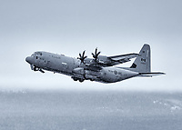 Gear up! A Royal Canadian Air Force 436 Squadron CC-130J Hercules departs from snowy Whitehorse, Yukon.