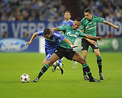Chelsea's Eden Hazard goes down under the challenge of FC Schalke 04 Dennis Aogo - Photo mandatory by-line: Joe Meredith/JMP - Tel: Mobile: 07966 386802 22/10/2013 - SPORT - FOOTBALL - Veltins-Arena - Gelsenkirchen - FC Schalke 04 v Chelsea - CHAMPIONS LEAGUE - GROUP E