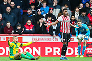 West Bromwich Albion forward Dwight Gayle (16) claims he was fouled by Brentford defender Julian Jeanvier (23), who thinks otherwise, during the EFL Sky Bet Championship match between Brentford and West Bromwich Albion at Griffin Park, London, England on 16 March 2019.