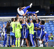 John Terry of Chelsea gets throw up in the air by his team mates after the Barclays Premier League match against Leicester City at Stamford Bridge, London<br /> Picture by Andrew Timms/Focus Images Ltd +44 7917 236526<br /> 14/05/2016