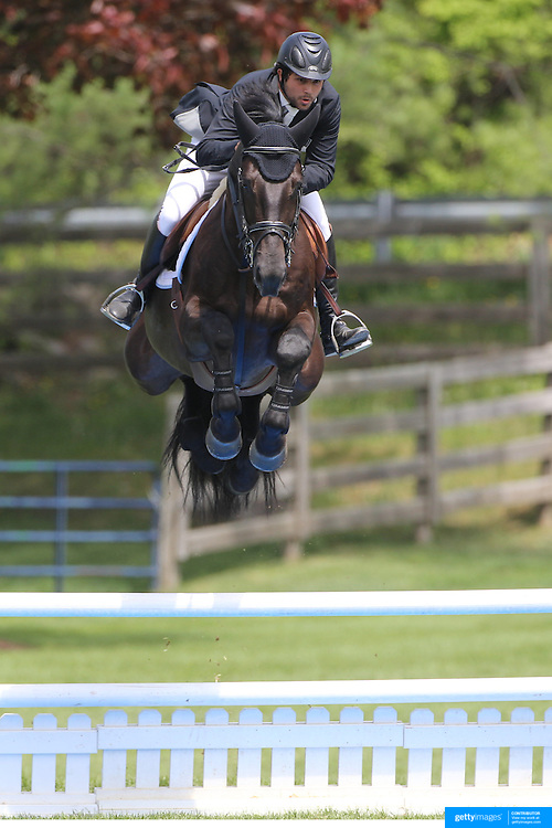 Axel Barrios riding VDL Aberlino in action during the $35,000 Grand Prix of North Salem presented by Karina Brez Jewelry during the Old Salem Farm Spring Horse Show, North Salem, New York, USA. 15th May 2015. Photo Tim Clayton