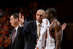 Virginia head coach Dave Leitao talks to Virginia guard/forward Mamadi Diane (24) on the bench.  The Virginia Cavaliers men's basketball team hosted the Clemson Tigers at the John Paul Jones Arena in Charlottesville, VA on February 7, 2008.