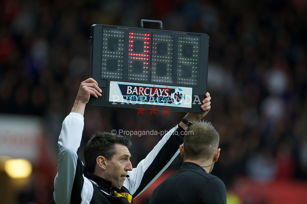 SWANSEA, WALES - Sunday, December 23, 2012: The fourth official adds four minutes of stoppage time during the Premiership match between Swansea City and Manchester United at the Liberty Stadium. (Pic by David Rawcliffe/Propaganda)