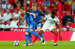 Marcus Rashford of England loses possession to Stanislav Lobotka of Slovakia - Mandatory by-line: Robbie Stephenson/JMP - 04/09/2017 - FOOTBALL - Wembley Stadium - London, United Kingdom - England v Slovakia - 2018 FIFA World Cup Qualifier