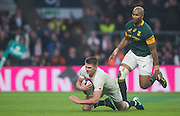 Twickenham, United Kingdom.  Owen FARRELL drops down to score a second half try, Springbok,  JP PIETERSEN, watches on, during the Old Mutual Wealth Series match.: England vs South Africa, at the RFU Stadium, Twickenham, England, Saturday, 12.11.2016<br /> <br /> [Mandatory Credit; Peter Spurrier/Intersport-images]