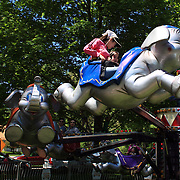 Adults and young children enjoy the fun rides during the May Fair at Saint Mark's Church, New Canaan, Connecticut, USA. 12th May 2012. Photo Tim Clayton