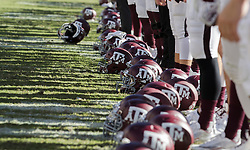 Members ofd the Texas A&M football team stand with their helmets at their feet during the singing off the Aggie War Hymn after beating UTSA in an NCAA college football game Saturday, Nov. 19, 2016, in College Station, Texas. (AP Photo/Sam Craft)