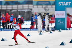 KAWAYOKE Taiki JPN LW5/7 competing in the ParaSkiDeFond, Para Nordic Skiing, 20km at  the PyeongChang2018 Winter Paralympic Games, South Korea.