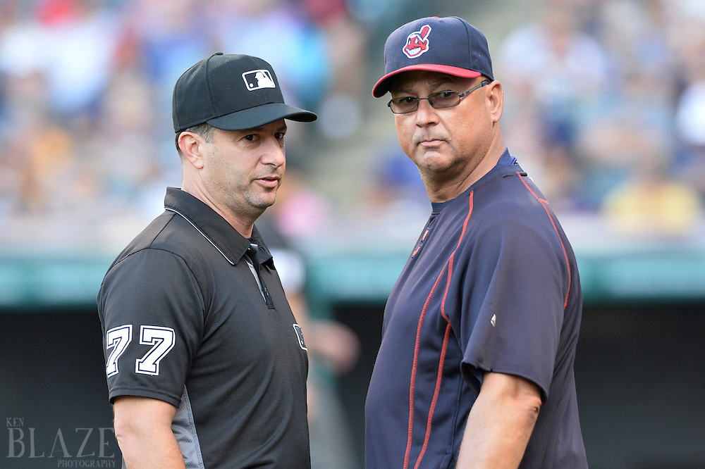 Aug 1, 2016; Cleveland, OH, USA; umpire Jim Reynolds (77) talks with Cleveland Indians manager Terry Francona (17) during a challenge in the first inning at Progressive Field. Mandatory Credit: Ken Blaze-USA TODAY Sports