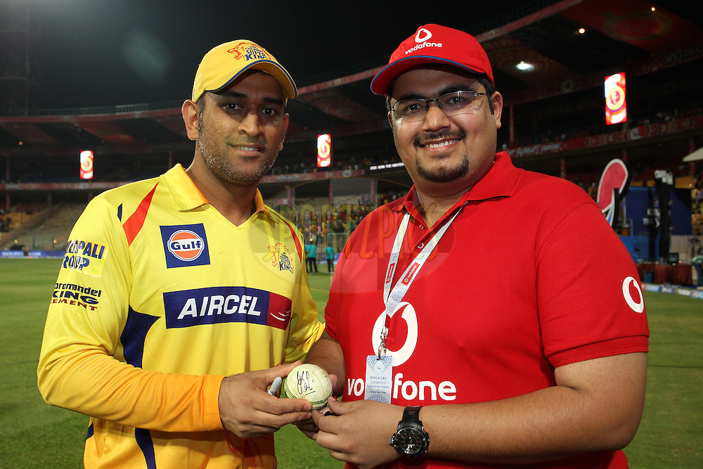 Chennai Super Kings Captain MS Dhoni with the Vodafone Superfan during match 20 of the Pepsi IPL 2015 (Indian Premier League) between The Royal Challengers Bangalore and The Chennai Superkings held at the M. Chinnaswamy Stadium in Bengaluru, India on the 22nd April 2015.<br /> <br /> Photo by:  Shaun Roy / SPORTZPICS / IPL
