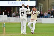 Somerset celebrate the Win - Jack Leach and James Hildreth of Somerset celebrate the run out of Steve Magoffin of Worcestershire which won the match during the Specsavers County Champ Div 1 match between Somerset County Cricket Club and Worcestershire County Cricket Club at the Cooper Associates County Ground, Taunton, United Kingdom on 22 April 2018. Picture by Graham Hunt.
