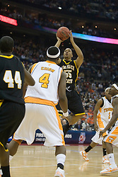 Long Beach State 49ers guard Aaron Nixon (55) shoots over Tennessee Volunteers forward Wayne Chism (4) .  The #5 seed Tennessee Volunteers defeated the #12 seed Long Beach State 49ers 121-86  in the first round of the Men's NCAA Tournament in Columbus, OH on March 16, 2007.