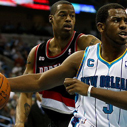March 30, 2011; New Orleans, LA, USA; New Orleans Hornets point guard Chris Paul (3) drives past Portland Trail Blazers power forward Marcus Camby (23) during the first half at the New Orleans Arena.    Mandatory Credit: Derick E. Hingle