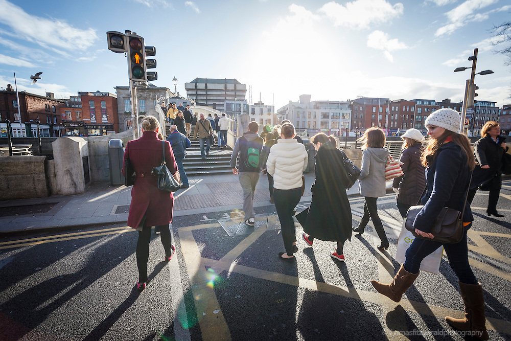 2012: Dublin, Ireland. Pedestrian Crossing at the Quay by the Ha'Penny Bridge  in Dublin