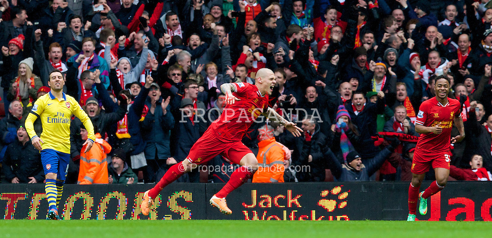 LIVERPOOL, ENGLAND - Saturday, February 8, 2014: Liverpool's Martin Skrtel celebrates scoring the second goal against Arsenal during the Premiership match at Anfield. (Pic by David Rawcliffe/Propaganda)
