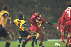 Liverpool, England - Wednesday, November 27th, 1996: Liverpool's John Barnes and Arsenal's Patrick Vieira during the 4th Round of the League Cup at Anfield. (Pic by David Rawcliffe/Propaganda)