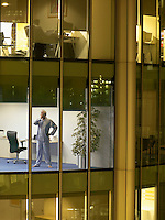 Male surgeon standing in office view from building exterior