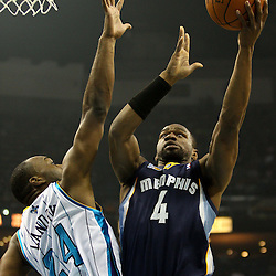 April 1, 2011; New Orleans, LA, USA; Memphis Grizzlies shooting guard Sam Young (4) shoots over New Orleans Hornets power forward Carl Landry (24) during the first quarter at the New Orleans Arena.    Mandatory Credit: Derick E. Hingle