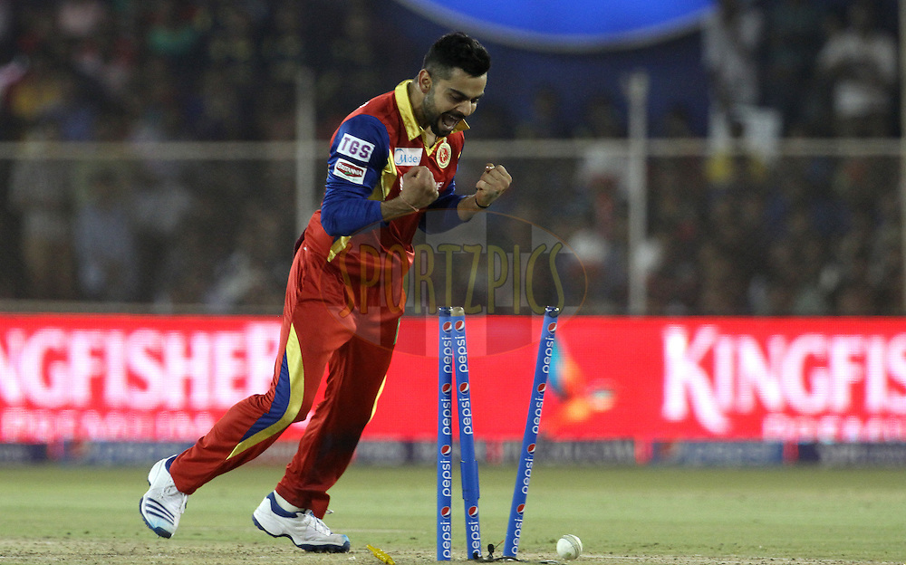 Royal Challengers Bangalore captain Virat Kohli celebrates the wicket Rajasthan Royals player Karun Nair during match 22 of the Pepsi IPL 2015 (Indian Premier League) between The Rajasthan Royals and The Royal Challengers Bangalore held at the Sardar Patel Stadium in Ahmedabad , India on the 24th April 2015.<br /> <br /> Photo by:  Vipin Pawar / SPORTZPICS / IPL