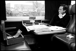 """File Photo - Prime Minister David Cameron leaves official red box behind on train.<br /> The Prime Minister David Cameron working on the train to Cardiff, Tuesday July 26, 2011.  Photo By Andrew Parsons / i-Images.<br /> <br /> The Prime Minister who was going to a wedding near York got the 7.44am train at King's Cross on Saturday 7th September 2013. The PM departed the train, leaving the red box behind with the key still in it and no security within touching distance. A No10 spokesman said last night: 'The box was not left unattended.<br /> """"The Prime Minister's security detail was there at all times.""""<br />  Monday 9th September, 2013.  Photo By Andrew Parsons / i-Images."""