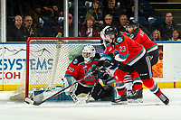 KELOWNA, BC - OCTOBER 12: Jake Poole #23 clears the puck from in front of the net of Roman Basran #30 of the Kelowna Rockets against the Kamloops Blazers at Prospera Place on October 12, 2019 in Kelowna, Canada. (Photo by Marissa Baecker/Shoot the Breeze)