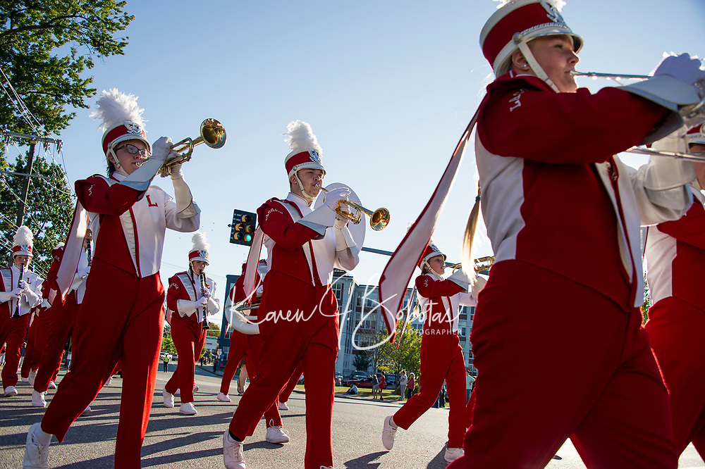 Laconia High School marching band along the parade route during LHS Homecoming parade Friday afternoon.  (Karen Bobotas/for the Laconia Daily Sun)