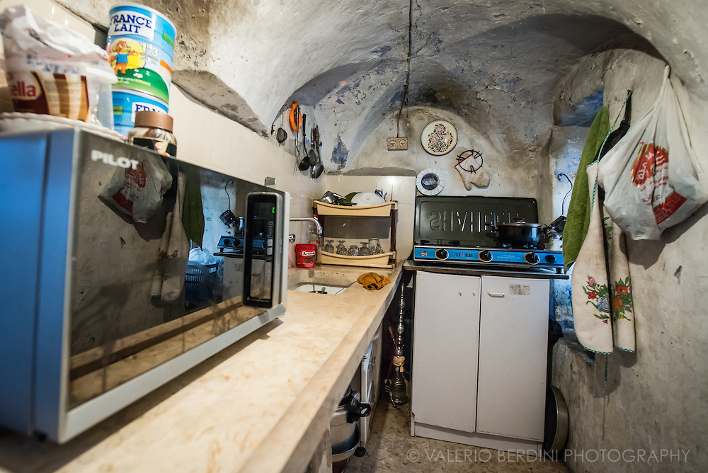 A tiny room adapted as a kitchen. Baby milk, a narghile and few tools are stored. Many areas of Palestinian houses became off-limit once the close buildings were occupied by settlers. At least three Palestinian schools have been closed and given to Israeli.