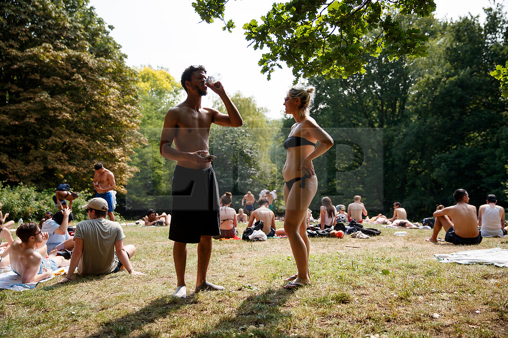 © Licensed to London News Pictures. 21/06/2017. London, UK. People sunbathe in Hampstead Heath Park in north London as temperatures hit 34C and makes it the hottest UK June day since 1976 on Wednesday, 21 June 2017. Photo credit: Tolga Akmen/LNP