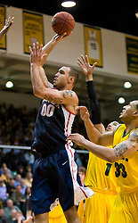 January 30, 2010; San Francisco, CA, USA;  Gonzaga Bulldogs center Robert Sacre (00) shoots against the San Francisco Dons during the second half at the War Memorial Gym.  San Francisco defeated Gonzaga 81-77 in overtime.