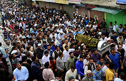 June 15, 2018 - Baramullah, Jammu and Kashmir, India - People wait for the dead body of  Shujaat Bukhari, slain Editor-in-Chief of the Kashmir Based Local English daily newspaper Rising Kashmir, during his funeral at Kreeri area of Baramullah District of Indian Administered Kashmir. Bukhari was killed after unknown gunmen shot on his vehicle killing Bukhari and two of his Body Guards. However, no Kashmir militant group has claimed the responsibility and has urged United Nations to probe the Killing of the Senior Editor internationally. (Credit Image: © Muzamil Mattoo/Pacific Press via ZUMA Wire)