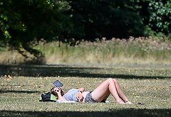 © Licensed to London News Pictures. 01/08/2018. LONDON, UK.  A woman sunbathes during warm weather in Hyde Park.  Temperatures are forecast to increase back to the 30s in time for the weekend  Photo credit: Stephen Chung/LNP