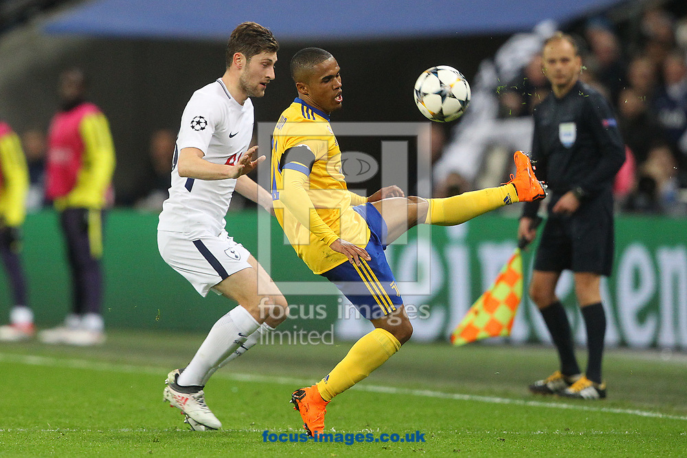 Ben Davies of Tottenham Hotspur and Douglas Costa of Juventus in action during the UEFA Champions League match at Wembley Stadium, London<br /> Picture by Paul Chesterton/Focus Images Ltd +44 7904 640267<br /> 06/03/2018
