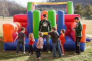 Kids line up to take a turn on the inflatable obsitcle corse during the Fieldhose Fest on Sibs Weekend.