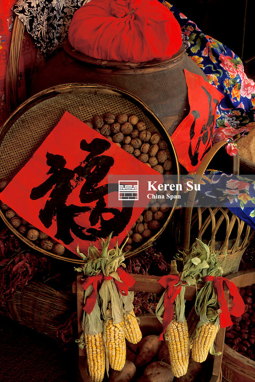 """Chinese motif calligraphy of """"Fortune"""" written on red paper and symbols of harvest China"""