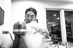Alvin Schultz using liquid nitrogen to make instant ice cream. (Editorial)