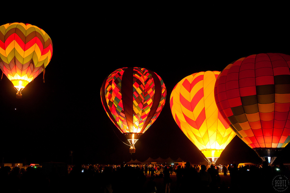 """Dawn Patrol 3"" - Photograph of lit up hot air balloons launching during the Dawn Patrol at the 2011 Great Reno Balloon Race."