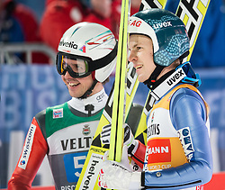 06.01.2015, Paul Ausserleitner Schanze, Bischofshofen, AUT, FIS Ski Sprung Weltcup, 63. Vierschanzentournee, Finale, im Bild Simon Ammann (SUI), Michael Hayboeck (AUT) // Simon Ammann of Switzerland and Michael Hayboeck of Austria reacts after his first competition Jump of 63rd Four Hills Tournament of FIS Ski Jumping World Cup at the Paul Ausserleitner Schanze, Bischofshofen, Austria on 2015/01/06. EXPA Pictures © 2015, PhotoCredit: EXPA/ Johann Groder
