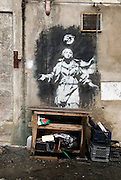 Naples, Italy, November 21, 2006-Graffiti next to a shop in an alley in Naples.