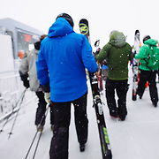 Skiers exit the Jackson Hole Mountain Resort Tram at the top of Rendevous Peak.
