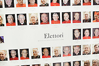 VATICAN CITY - 13 MARCH 2013: A poster with the 115 voters (elettori, in italian), which are the 115 cardinals entering the conclave to elect the new Pope, is shown in the Vatican Media Center in Vatican City, on March 13, 2013...On March 12, 2013, the 115 cardinals entered the conclave to elect a successor to Pope Benedict XVI after he became the first pope in 600 years to resign from the role. The conclave will take place inside the Sistine Chapel and will be attended by 115 cardinals as they vote to select the 266th Pope of the Catholic Church.